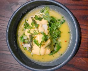 A dish of snapper and butter sauce